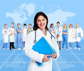 Doctor woman with a medical team. Health care background.