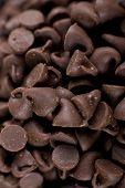 pic of chocolate-chip  - Vertical image of a chocolate chip pile - JPG