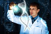 stock photo of biotechnology  - Image of DNA strand against colour background - JPG