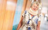 image of neck brace  - A Senior Woman Wearing A Neck brace - JPG