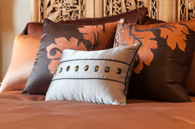 stock photo of woodcarving  - Luxury hotel room setting with bed and pillows - JPG
