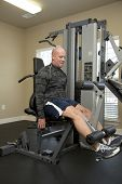 foto of gun shot wound  - Solder exercising in gym He suffered gun shot wounds in Iraq and is recovering - JPG