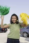 Hispanic girl waving pom poms