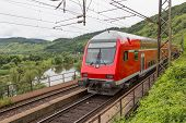 image of moselle  - Train driving along river Moselle in Germany - JPG