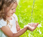 picture of water jet  - Stream of clean water pouring into children - JPG
