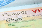 pic of passbook  - Close up shot of Canadian visa stamp - JPG