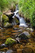 image of boggy  - Boggy Creek stream flowing over rocks near Mt Buller Victoria Australia - JPG
