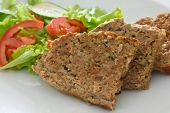 stock photo of meatloaf  - Baked meatloaf and fresh salad on white plate - JPG