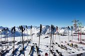 pic of pole  - Scattered skis and ski poles at ski resort - JPG