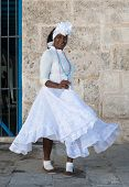 HAVANA,CUBA - JANUARY 20, 2014:Afro woman dressed with typical clothes.Characters like this are comm