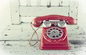 picture of toy phone  - Red toy telephone on old light blue wooden chair with vintage editing - JPG