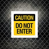 stock photo of chain link fence  - Caution sign  - JPG