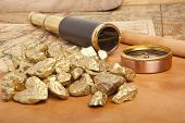 image of gold nugget  - Gold nuggets and vintage brass telescope on antique map - JPG