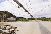stock photo of nonrenewable  - Transalaska oil pipeline and Richardson Hwy Bridges over Tanana river near Delta Junction, AK ** Note: Slight blurriness, best at smaller sizes - JPG