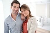 pic of 35 to 40 year olds  - Couple standing in contemporary home - JPG