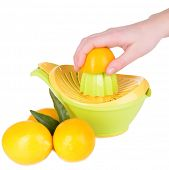 Preparing fresh lemon juice squeezed with hand juicer isolated on white