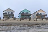 stock photo of outer  - Row of colorful Cape Hatteras beach houses in the Outer Banks of North Carolina USA - JPG