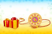 picture of pooja  - vector illustration of decorated rakhi with gift for Raksha Bandhan - JPG