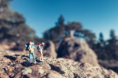 image of figurines  - Miniature hikers travelling with backpacks - JPG