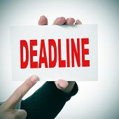 pic of last day work  - woman hand holding a signboard with the word deadline written in it - JPG