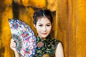 picture of traditional attire  - Chinese girl in traditional Chinese cheongsam blessing - JPG