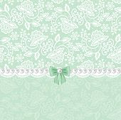 stock photo of lace  - Wedding or baby shower invitation or greeting card with white lace on green background - JPG