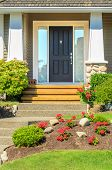 stock photo of brownstone  - A very clean entrance of a house with a nice lawn and outdoor landscape - JPG