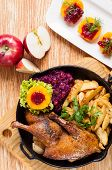 picture of barbary duck  - Roasted duck and potato wedges in the pan - JPG