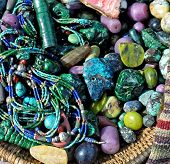 Semiprecious stone beads in a basket