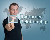 pic of customer relationship management  - Young man press digital Customer Relationship button on interface in front of him - JPG