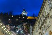 stock photo of pendulum clock  - Clock Tower of Graz Austria at Night - JPG
