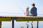 picture of father daughter  - Father and daughter fishing on the pier - JPG
