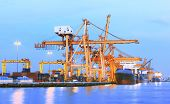 picture of ship  - beaitiful landscape of heavy crane tool in ship port and container yard use for import  - JPG