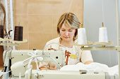 image of tailoring  - female tailor working with cloth in sewing workshop - JPG