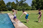 foto of playtime  - Boy girls playtime swimming pool home summer - JPG