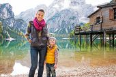 stock photo of south tyrol  - Portrait of happy mother and baby on lake braies in south tyrol italy - JPG
