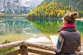 pic of south tyrol  - Young woman with map on lake braies in south tyrol italy - JPG