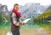 pic of south tyrol  - Happy young woman with map on lake braies in south tyrol italy - JPG