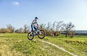 image of dirt-bike  - Teenage Boy Racing With His Dirt Bike - JPG
