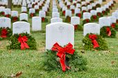 stock photo of arlington cemetery  - Gravestones with Christmas wreaths in Arlington National Cemetery  - JPG