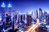 stock photo of glow  - Dubai downtown night scene - JPG