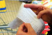picture of receipt  - Supermarket shop. Closeup of paper check receipt bill in human hand. Paying and retail.