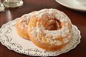 image of doilies  - Cake donuts with powdered sugar on a doily - JPG