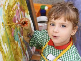 foto of school child  - artist school little girl painting brush watercolors portrait - JPG