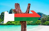 stock photo of dauphin  - Madagascar Flag wooden sign with beach background - JPG