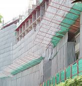 image of awning  - Construction cloth attached to the scaffolding  - JPG