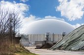 picture of biogas  - Biogas plant against blue sky with clouds copy space - JPG
