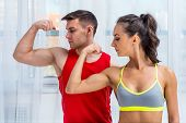 pic of sportive  - Active athletic sportive woman girl and man showing their muscles biceps healthy lifestyle - JPG