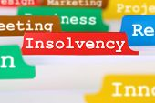 stock photo of liquid  - Insolvency bankruptcy or liquidation business concept problem register in documents