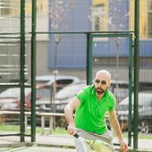 image of early-man  - young man play tennis outdoor on tennis field at early morning - JPG